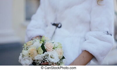 Young woman hold bouquet in her han - Wedding bouquet in...