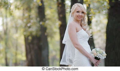 Young woman pose to photographer. W - Happy bride outdoor...