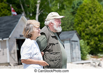 Senior couple in front of boathouses
