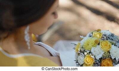 Young woman hold yellow bouquet in her arms Wedding photo...