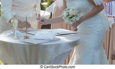 Bride signature wedding contract, papers - Happy moment in...