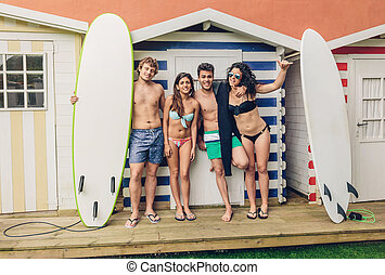 Group of people in swimsuit having fun outdoors