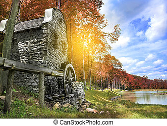Old water mill.  - Old water mill on the lake in autumn.