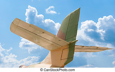Tail of aircraft, blue sky background - Tail section of a...