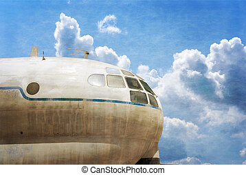 Military transport plane, blue sky background