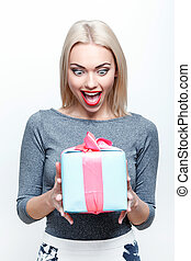 Amazed blond-haired woman getting present - What surprised...