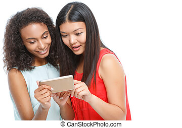 Pleasant girls holding smart phone. - Ready to talk. Nice...