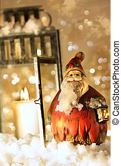 Brightly lit lantern in the snow with little Santa