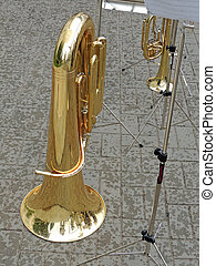 Rain drops on a tuba - Tuba and music stand with musical...