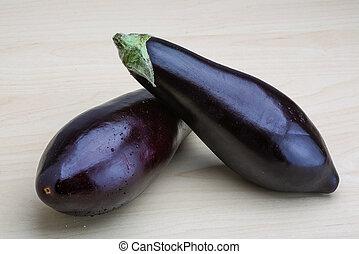 Eggplants - Two raw Eggplants on the wood background