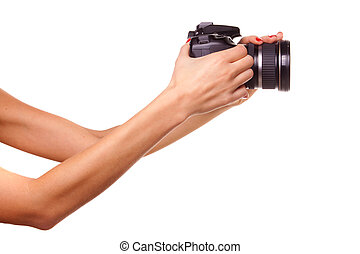 Women\'s hands holding the camera. Isolated on white.