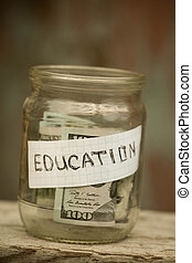 Jar with coins labeled education.
