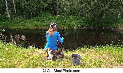 woman fish pond and cat - Young blond woman sit on birch...