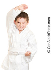 Funny karate kid in defense stance photo against white...
