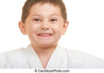Grimacing karate kid