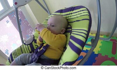 cute baby in swing