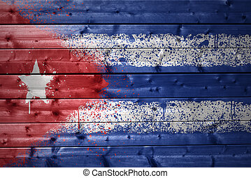 painted cuban flag on a wooden texture
