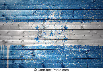 painted honduran flag on a wooden texture - colorful painted...