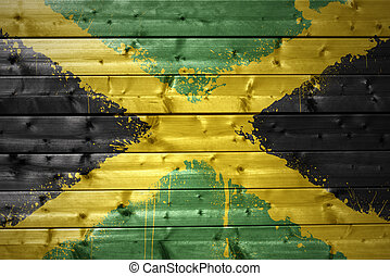 painted jamaican flag on a wooden texture