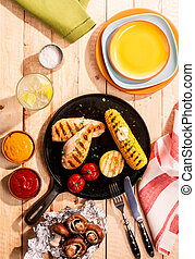 Grilled chicken breasts and corn on the cob
