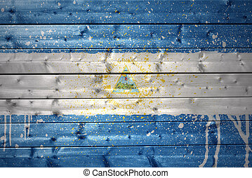 painted nicaraguan flag on a wooden texture - colorful...