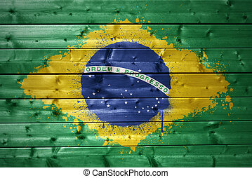 painted brazilian flag on a wooden texture