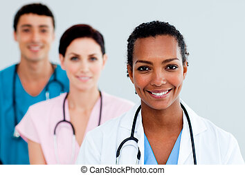 Attractive female Doctor standing before her team
