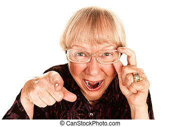 Senior woman laughing - Senior woman pointing her finger and...