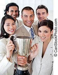 A successful business team holding a trophy. Concept of...
