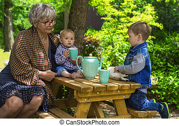 Tea time with grandmother - Grandmother having tea with her...