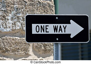 One way sign on street