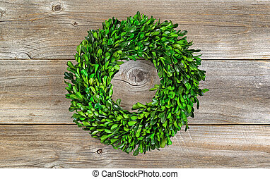 Green Boxwood Leaf Wreath on Rustic Wood - Wreath made with...