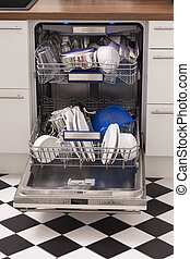 Dishwasher loades in a kitchen with clean dishes and blue...
