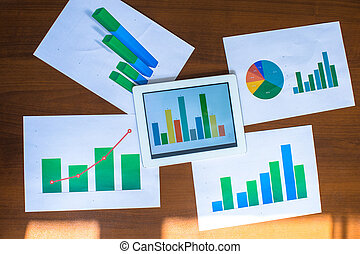 Business chart showing financial success on paper