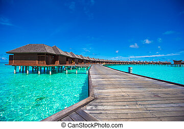 Water bungalows and wooden jetty on Maldives - Water...