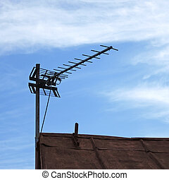 TV antenna over old roof - Television antenna over old metal...