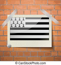 Flags Brittany scotch taped to a red brick wall - Flags of...