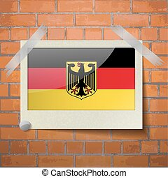Flags Germany scotch taped to a red brick wall - Flags of...