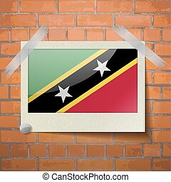 Flags Saint Kitts Nevis scotch taped to a red brick wall -...