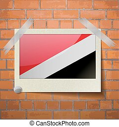 Flags Sealand Principality scotch taped to a red brick wall...