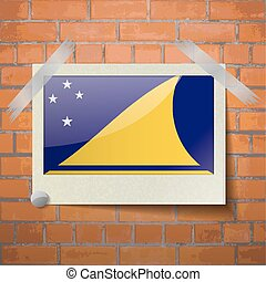 Flags Tokelau scotch taped to a red brick wall - Flags of...