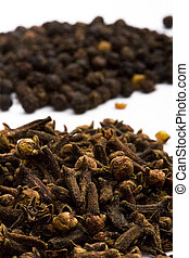 cloves and black pepper - macro image of spises: cloves and...