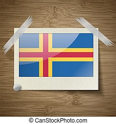 Flags Aland at frame on wooden texture. Vector