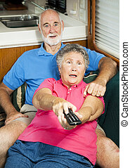 RV Seniors - Shocked by TV Content - Senior couple watching...