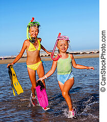 Children playing on beach. - Children running on beach for...