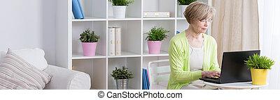 Elder businesswoman at home - Elder hardworking...