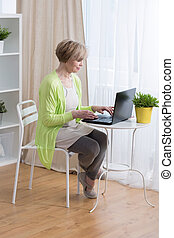 Woman running business - Senior retired woman running...