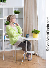 Relax time at home - Woman in middle age and her relax time...