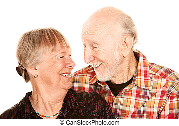 Smiling senior couple on white background