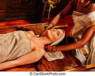 Woman having ayurveda spa treatment. - Woman having facial...
